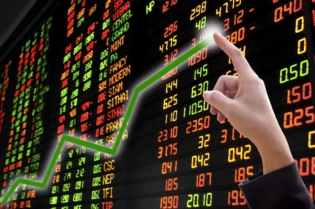 stocks and shares: Businesswomans hand on chart showing positive growth trend  Stock Photo