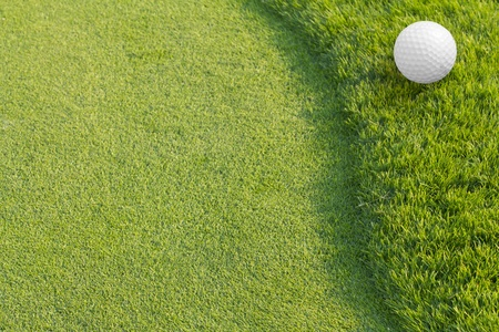 golf equipment: Golf ball on green tee