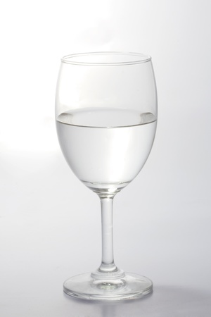 otimismo: Glass of water half empty isolated on white background
