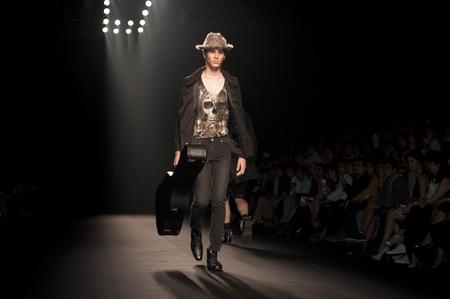 THAILAND -MAR 26 : A model is walking the runway at 27Nov collection presentation for Fashion Networking during Bangkok International Fashion Week 2011 on March 26, 2011 in Bangkok,Thailand