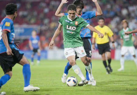 BANGKOK THAILAND- APRIL 3 : Thai Premier League (TPL) between TOT (Blue) vs BC Fc (Green) on April 3, 2011 at  Thunderdome Stadium Bangkok, Thailand Stock Photo - 9256623