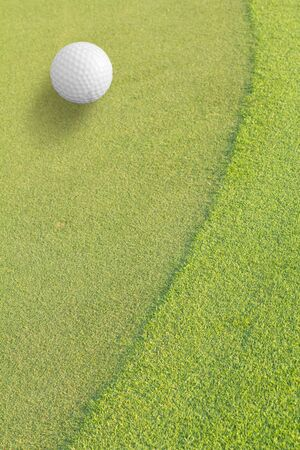 Golf ball on green tee Stock Photo - 9312897