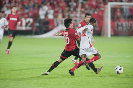 winning pitch: NONTHABURI THAILAND- APRIL 12 : AFC CUP between Muang Thong utd (Red) vs Victory sc  (white) on April 12, 2011 at  Yamaha Stadium Nonthaburi, Thailand Editorial