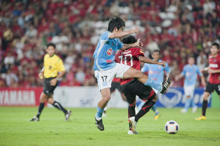 THAILAND- APR 17 : Thai Premier League (TPL) between Muang Thong utd (Red) vs SCG Samutsongkram Fc (Blue) on April 17, 2011 at  Yamaha Stadium Bangkok, Thailand