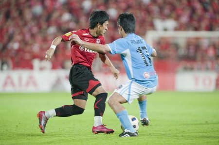 THAILAND- APR 17 : Thai Premier League (TPL) between Muang Thong utd (Red) vs SCG Samutsongkram Fc (Blue) on April 17, 2011 at  Yamaha Stadium Bangkok, Thailand Stock Photo - 9338536