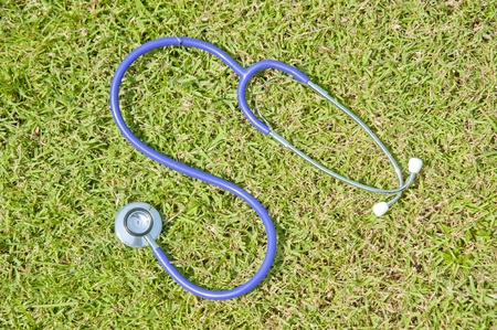 stethoscope on grass  Stock Photo