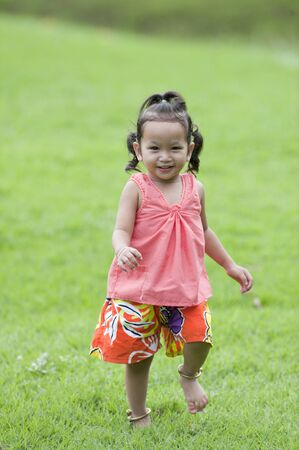 A little girl in the park. Stock Photo - 9492592