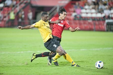 NONTHABURI THAILAND - MAY 25 :the AFC CUP between Muang Thong UTD vs Al Ahed Fc on May 25, 2011 at Yamaha Stadium in Nonthaburi, Thailand  Stock Photo - 9587801