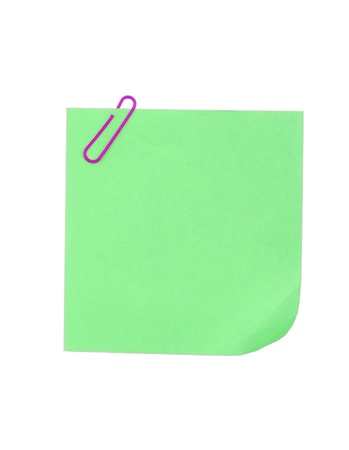 Blank sticky note with paper clip on white background  photo