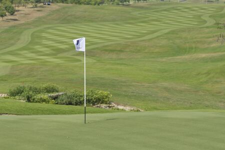 Golf: sand trap on the green grass  photo