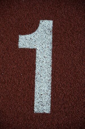 Number 1 on the start of a running track - check my portfolio for other numbers Stock Photo - 9982725