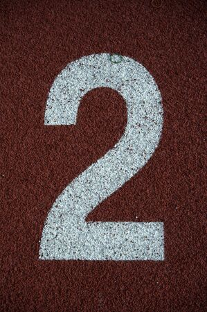 Number 2 on the start of a running track - check my portfolio for other numbers Stock Photo - 9982734