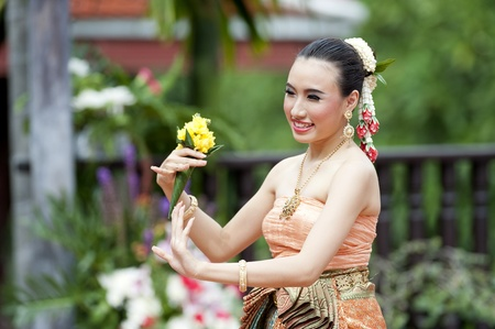 Women : Thai Traditional Dress. This is the parade of making traditional merit of people from the northern territory of Thailand photo