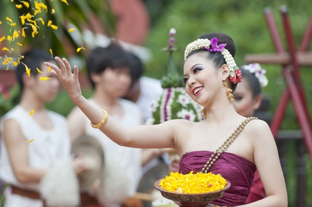 BANGKOK, THAILAND - JULY 10 : Thai traditional dance. This is the parade of making traditional merit of people from the northern territory of Thailand, July 10, 2011 in Bangkok, Thailand.  Stock Photo - 9915977