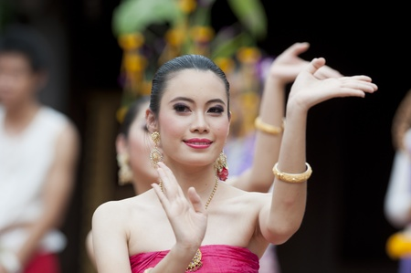 BANGKOK, THAILAND - JULY 10 : Thai traditional dance. This is the parade of making traditional merit of people from the northern territory of Thailand, July 10, 2011 in Bangkok, Thailand.