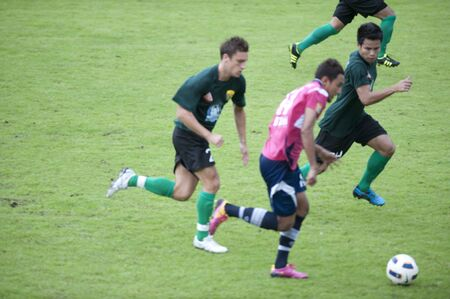 BANGKOK THAILAND - JULY 20 : Toyota League Cup between BBCU fc (prink) vs Kasetsat fc (green) on July 20, 2011 at  Kasetsat Stadium Bangkok, Thailand