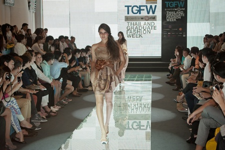 famous industries: BANGKOK, THAILAND - SEPTEMBER 16 : Model showcases on the catwalk during Thailand Graduate Fashion Week 2011 ( TGFW ) on September 16, 2011 in Bangkok Thailand.  Editorial