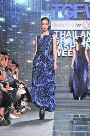 BANGKOK, THAILAND - SEPTEMBER 16 : Model showcases on the catwalk during Thailand Graduate Fashion Week 2011 on September 16, 2011 in Bangkok Thailand.
