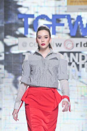 BANGKOK, THAILAND - SEPTEMBER 16 : Model showcases on the catwalk during Thailand Graduate Fashion Week 2011 on September 16, 2011 in Bangkok Thailand.  Stock Photo - 10592227