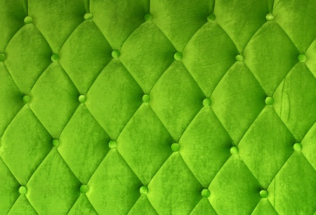 button tufted: Green button-tufted leather background