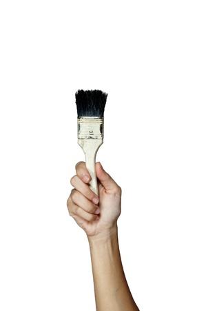 Pincel de mano y pintura aislada sobre fondo blanco