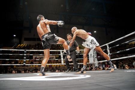 unrivalled: BANGKOK THAILAND- SEPTEMBER 25 : Thai Fight : Muay Thai..Worlds Unrivalled Fight on September 25, 2011 at Thammasat University Cnvention Center,Bangkok Thailand