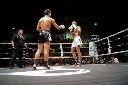 unrivalled: BANGKOK THAILAND- SEPTEMBER 25 : Thai Fight : Muay Thai..Worlds Unrivalled Fight on September 25, 2011 at Thammasat University Cnvention Center,Bangkok Thailand