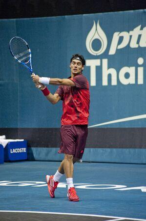 atp: BANGKOK THAILAND- SEPTEMBER 28 : D.Udomchoke vs F.Fognini action in PTT Thailand Open 2011 ( ATP ) on September 24, 2011 at Impact Arena Muang Thong Thani Bangkok Thailand