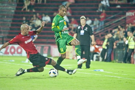 BANGKOK, THAILAND - NOV 22 :  in action during Thai Premier League (TPL) between Muang Thong Utd (R) and Army Utd (G) at Yamaha Stadium on November 22, 2011 in Bangkok, Thailand