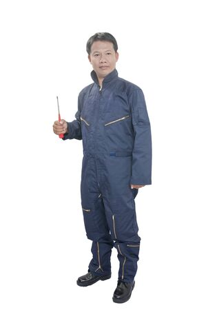 boiler suit: Smiling young mechanic in boiler suit against a white background