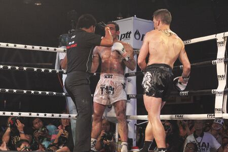 unrivalled: BANGKOK, THAILAND- NOV 27 : Unidentified boxers compete in Thai Fight:Muay Thai. Worlds Unrivalled Fight on November 27, 2011 at Convention Hall, Imperial World Samrong, Samutprakan, Thailand