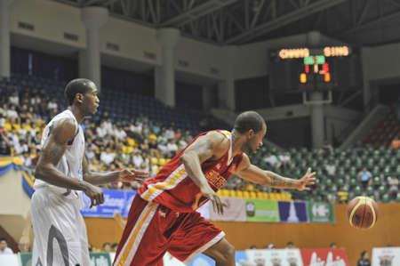 BANGKOK, THAILAND - FEB 5 : Asean Basketball League 2012 (ABL) between Slammers(W) vs Leader(R) at Thai-Japanese Stadium on February 5, 2012 in Bangkok, Thailand  Stock Photo - 12368390