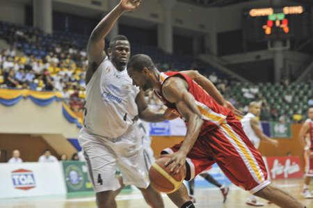 BANGKOK, THAILAND - FEB 5 : Asean Basketball League 2012 (ABL) between Slammers(W) vs Leader(R) at Thai-Japanese Stadium on February 5, 2012 in Bangkok, Thailand  Stock Photo - 12368429