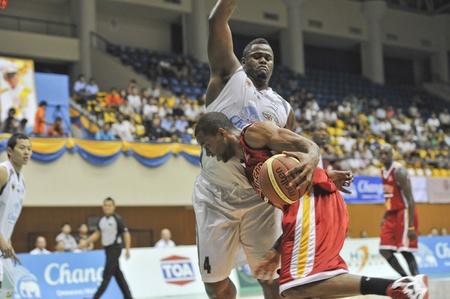 BANGKOK, THAILAND - FEB 5 : Asean Basketball League 2012 (ABL) between Slammers(W) vs Leader(R) at Thai-Japanese Stadium on February 5, 2012 in Bangkok, Thailand  Stock Photo - 12368428