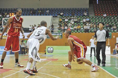 BANGKOK, THAILAND - FEB 5 : Asean Basketball League 2012 (ABL) between Slammers(W) vs Leader(R) at Thai-Japanese Stadium on February 5, 2012 in Bangkok, Thailand  Stock Photo - 12368432