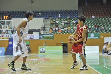 BANGKOK, THAILAND - FEB 5 : Asean Basketball League 2012 (ABL) between Slammers(W) vs Leader(R) at Thai-Japanese Stadium on February 5, 2012 in Bangkok, Thailand  Stock Photo - 12368391