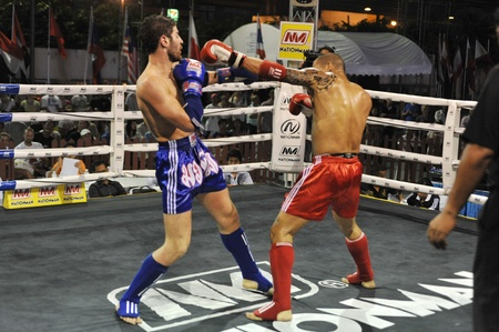 BANGKOK, THAILAND- MARCH 22 : Unidentified athletes compete in World Amateur Muaythai Champioships 2012. on March 22, 2012 at National Stadium, Bangkok, Thailand  Editorial
