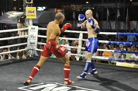 BANGKOK, THAILAND- MARCH 22 : Unidentified athletes compete in World Amateur Muaythai Champioships 2012. on March 22, 2012 at National Stadium, Bangkok, Thailand  Stock Photo - 12925937