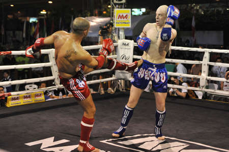 BANGKOK, THAILAND- MARCH 22 : Unidentified athletes compete in World Amateur Muaythai Champioships 2012. on March 22, 2012 at National Stadium, Bangkok, Thailand  Stock Photo - 13161762