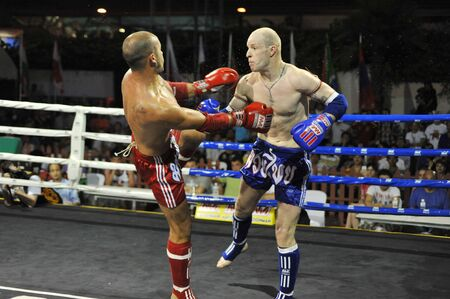 BANGKOK, THAILAND- MARCH 22 : Unidentified athletes compete in World Amateur Muaythai Champioships 2012. on March 22, 2012 at National Stadium, Bangkok, Thailand  Stock Photo - 13161761
