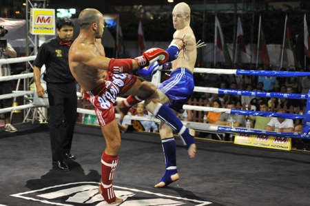 BANGKOK, THAILAND- MARCH 22 : Unidentified athletes compete in World Amateur Muaythai Champioships 2012. on March 22, 2012 at National Stadium, Bangkok, Thailand  Stock Photo - 13256828