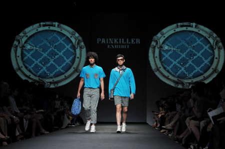 BANGKOK, THAILAND - MARCH 24  : Model walks the runway at ' Painliller ' collection presentation during Siam Center Fashion Visionary SpringSumme on March 24, 2012 in Bangkok Thailand.