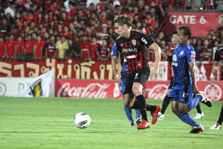 NONTHABURI THAILAND-MAY 28 : Unidentified player in Thai Premier League between SCG Muangthong Utd.(R) VS Chonburi FC (B) at SCG stadium on May 28, 2012 in Nonthaburi,Thailand.