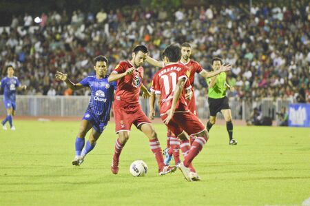 BANGKOK THAILAND - JULY 21 : Unidentified player in Thai Premier League (TPL) BEC Tero (red) VS Chonburi (Blue) at Thebhussadin on July 21,2012 in Bangkok,Thailand.