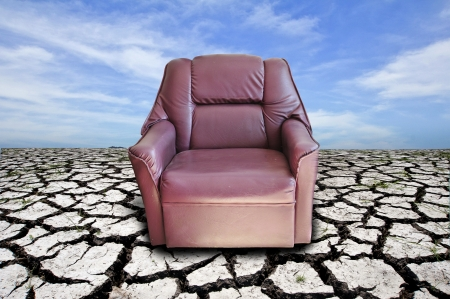 red armchair on cracked dried soil  Stock Photo - 14749862