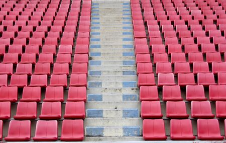Bright red stadium seats  photo