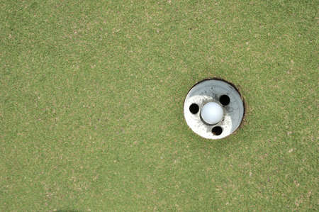 golf ball hole on a field  photo