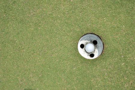 golf ball hole on a field  photo