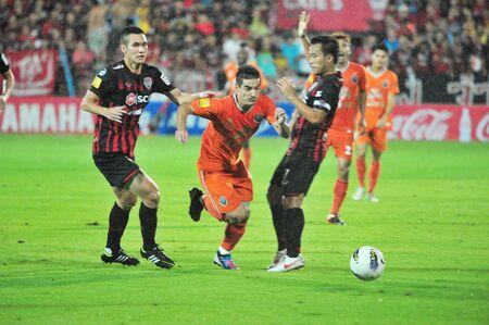 BANGKOK THAILAND - AUGUST 19 : Unidentified player in Thai Premier League (TPL) Between SCG Muangtohong Utd (R) VS Buriram Utd (O) at SCG Stadium on August 10,2012 in Bangkok,Thailand.