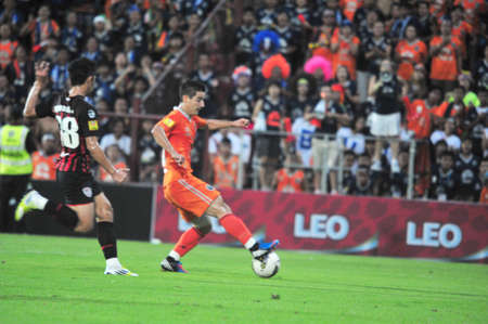 BANGKOK THAILAND - AUGUST 19 : Unidentified player in Thai Premier League (TPL) Between SCG Muangtohong Utd (R) VS Buriram Utd (O) at SCG Stadium on August 10,2012 in Bangkok,Thailand.
